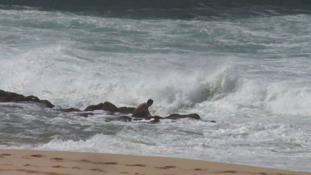 Bodyboarders get Washed Across the Rocks